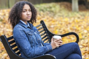 Depressed - mixed race African American girl teenager female