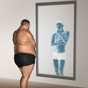 overweight vs slim fit with muscles young man on diet reflecting in a mirror