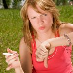 Girl refusing a cigarette